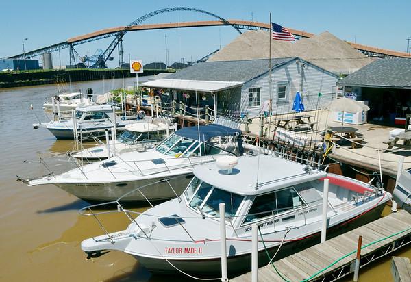 WARREN DILLAWAY / Star Beacon<br /> CHARTER FISHING boats line docks along the Ashtabula River.