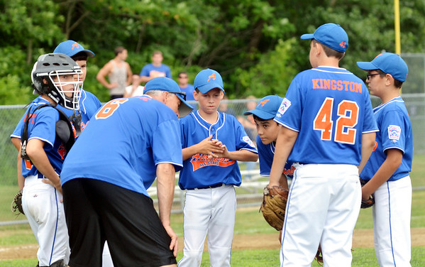 WARREN DILLAWAY / Star Beacon<br /> BRIAN MIHALICK, manager of the  Ashtabula Major League All Stars, 6  talks with his team during a break inthe action on Saturday . The opening round state tournament started 90 minutes late after a rain delay at Cederquist Park in Ashtabula.