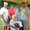 WARREN DILLAWAY / Star Beacon<br /> MARY PRESCIANO holds a plaque in honor of her late husband Joseph Presciano Jr. following a presentation in his honor prior to the opening of the Little League state tournament at Cederquist Park in Ashtabula on Saturday. (From left standing) Jim and Debbie LaPierre, of Geneva, and Kathy Presciano and Paul Vincent of Ashtabula. Presciano was a coach in the Ashtabula Little League and the family designated memorial contributions be made to Little League.