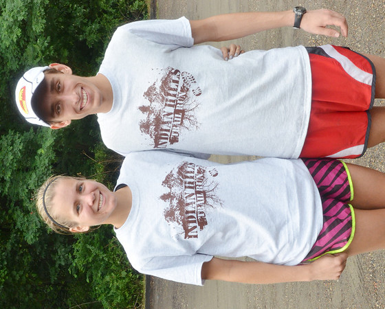 WARREN DILLAWAY / Star Beacon<br /> KATIE NOWAK, 26, of Willoughby, and Jonathan Gears, 20, of Andover, were the winners of the Indian Trails Eight Mile Adventure Run on Saturday morning in Ashtbula.
