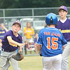 WARREN DILLAWAY / Star Beacon<br /> AUSTIN PAUKEN (left) of Maumee forces Kle Van Allen of Ashtabula at second base while Maumee's Carer McGannon watches on Saturday during opening round Major League state tournament action at Cederquist Park in Ashtabula Township.