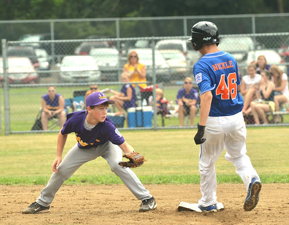 WARREN DILLAWAY / Star Beacon<br /> RON NICKLE of the Ashtabula Major League All Stars arrives safely at second base as Maumee's Carter McGannon applies a late tag on Saturday during opening day action of the state tournament at Cederquist Park in Ashtabula.