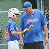 WARREN DILLAWAY / Star Beacon<br /> BRIAN MIHALICK, manager of the  Ashtabula Major League All Stars  talks with Ozzie Campbell during a break inthe action on Saturday . The opening round state tournament started 90 minutes late after a rain delay at Cederquist Park in Ashtabula.