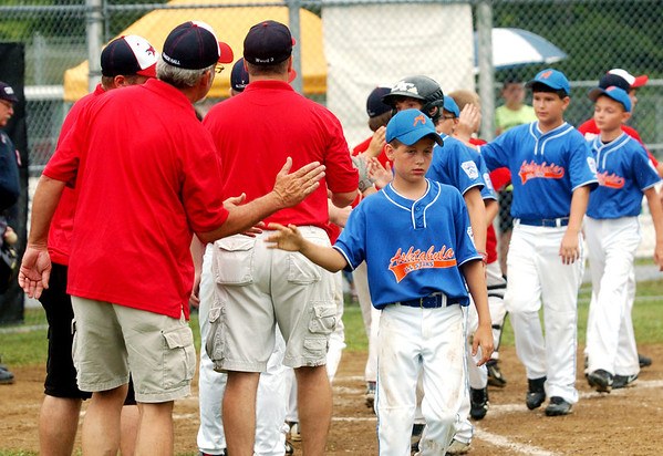 WARREN DILLAWAY / Star Beacon<br /> ANDREW MEHALIC (front facing) and his Ashtabula Major League All Stars shake hands with Washington Court House players and coaches after being eliminated from the state tournament on Monday afternoon at Cederquist Park in Ashtabula.