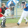 WARREN DILLAWAY / Star Beacon<br /> RON NICKLE of the Ashtabula Major League All Stars (right) covers his head while scoring a run while Josh Yoho of Washington Court House waits for the ball on Monday during state tournament action at Cederquist Park in Ashtabula.