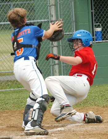 WARREN DILLAWAY / Star  Beacon<br /> JOHN ANSERVITZ (left) of the Ashtabula Major League All Stars prepares to tag Jarred Hall of Washington Court House during state tournament action at Cederquist Park in Ashtabula.