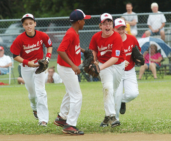 WARREN DILLAWAY / Star Beacon<br /> JARRED HALL (with glasses) of Washington Court House Major League All Star team celebrates after making a catch in centerfield on Monday during a state tournament game with Ashtabula at Cederquist Park.