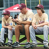 WARREN DILLAWAY / Star Beacon<br /> GEORGE ARENSHIELD (center) and his twin sons Alex (left) and Jake kill time waiting for their next game at the Little League State Tournament at Cederquist Park in Ashtabula on Tuesday afternoon.