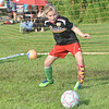 WARREN DILLAWAY / Star Beacon<br /> MAKENNA PROY, a fifth grader in the Geneva Area City Schools, works on his goalie skiils during the Mike Mikulin Memorial Soccer Camp in Geneva on Tuesday evening.