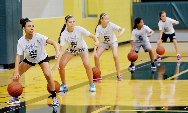 WARREN DILLAWAY / Star Beacon<br /> LAKESIDE BASKETBALL Camp participants (from left) Ana Presciano, Briehl Hathy, Dani Melnick, Alba DeValle and Olivia Palinkias work on ball handling drills on Friday at the high school gymnasium.