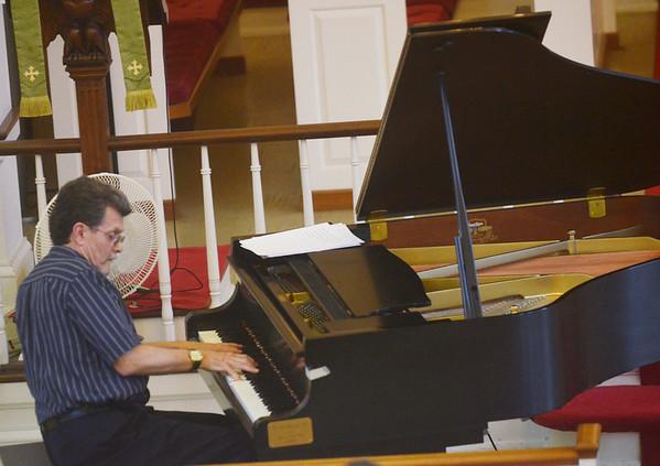 WARREN DILLAWAY / Star Beacon<br /> BILL DOBBINS, a jazz pianist, plays Friday evening at St. Peter's Episcopal Church in Ashtabula during the Ashtabula County Jazz Festival 2013.