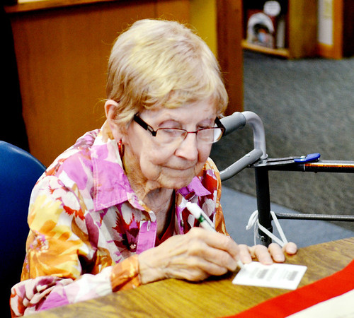 WARREN DILLAWAY / Star Beacon<br /> DOROTHY ANDRUS VASBINDER, who turns 100 years old today, prepares to sign her honorary library card at the Kingsville Public Library on Friday afternoon.
