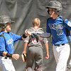 WARREN DILLAWAY / Star Beacon<br /> CLAYTON DETHERAGE (left) fist pumps Hamilton Major Leage All Star teammate Montana Allgaier after Allgaier hit a home run during state tournament action at Cederquist Park in Ashtabula on Friday afternoon.