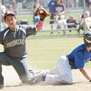 WARREN DILLAWAY / Star Beacon<br /> ALEX CORDONA (left) of the Boardman Majoe League All Stars shows the umpire the ball after tagging out Caleb Owens of Hamilton during state tournament action at Cederquist Park in Ashtabula on Friday afternoon.