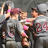 WARREN DILLAWAY / Star Beacon<br /> THE BOARDMAN Majoe League All Stars celebrate after a home run during state tournament action at Cederquist Park in Ashtabula on Friday afternoon.