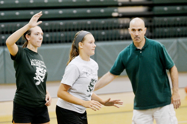 WARREN DILLAWAY / Star Beacon<br /> DAVE MALLONE, Lakeside girls basketball coach, watches over a drill with camper Kaytlyn Farr (center) and Lakeside high junior and camp helper Alexis Benedict.