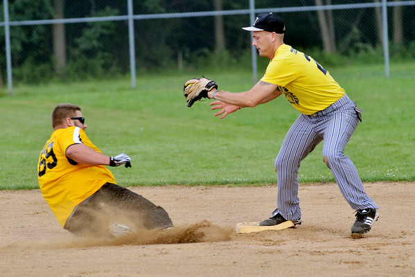 WARREN DILLAWAY / Star Beacon<br /> MARK FETTERS (right) of Geneva Spinal Health forces Ryan Cole of Bula Boyz at second base during Ashtabula Recreational League softball action on Monday night at Massucci Field.