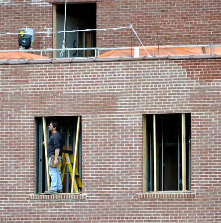 WARREN DILLAWAY / Star Beacon<br /> A CONSTRUCTION worker stands in one of the many open windows at the former Ashtabula Hotel on Main Avenue that is being rebuilt into the headquarters of Signature Health.