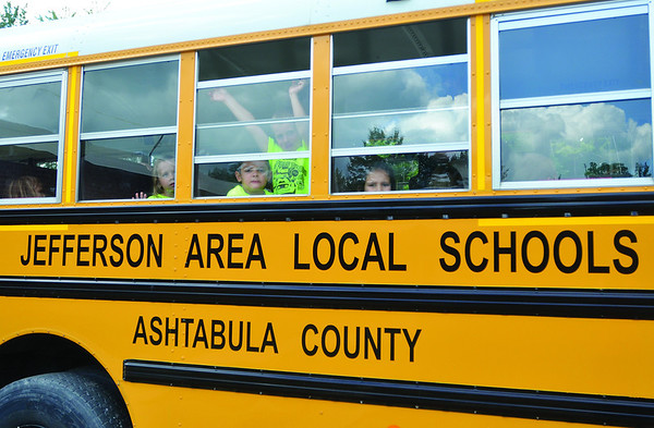 STACY MILLBERG / Star Beacon<br /> SAFETY TOWN participants got to take a ride in a school bus Tuesday in Jefferson.