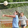 WARREN DILLAWAY / Star Beacon<br /> SHERRI BRITTON of the Fab 4  sets the ball as Shelley Fetters (background) of the Lethal Ladies watches on Tuesday night. The Fab 4 clinched the Softall City Sand Volleyball League championship with a victory.
