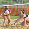 WARREN DILLAWAY / Star Beacon<br /> BRITTANY WENTWORTH (right) sets the ball with teammate Chelsey Miller reacting during the Softball City Sand Volleyball League Tuesday evening. The Fab 4 clinched the championship with a win over the Lethal Ladies.