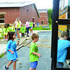 STACY MILLBERG / Star Beacon<br /> SAFETY TOWN participants board a school bus in Jefferson Tuesday.