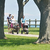 WARREN DILLAWAY / Star Beacon<br /> PITTSBURGH AREA residents (from left) James Fogarty, holding five month old Nora Fogartyy, Mary McFadden, and Erin Robleto and her 10 month olds son Teddy. They enjoy a walk along the bike path adjacent to the Lodge and Conference Center at Geneva-on-the-Lake.