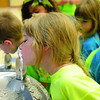 STACY MILLBERG / Star Beacon<br /> AURORA SLEIGH gets a drink of water during a tour of Jefferson Elementary School Tuesday as part of Safety Town. Sleigh will be starting kindergarten next month.