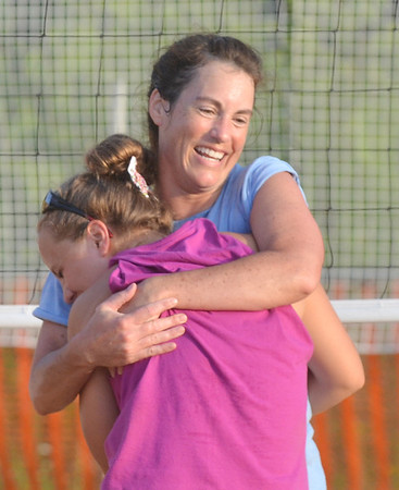 WARREN DILLAWAY / Star Beacon<br /> SHERRI BRITTON (facing) of the Fab 4 huggggs Chelsey Miller of the Lethal Ladies after the Fab 4 clinched the Softball City Sand Volleyball League championship on Tuesday evening.