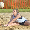 WARREN DILLAWAY / Star Beacon<br /> BRITTANY WENTWORTH of the Lethal Ladies sets the ball whil doing a split during the Softball City Sand Volleyball League Tuesday evening. The Fab 4 clinched the championship with a win over the Lethal Ladies.