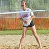 WARREN DILLAWAY / Star Beacon<br /> COURTNEY DIDONATO of the Fab 4 yells encouragement during the Softball City Sand Volleyball League Tuesday evening. The Fab 4 clinched the championship with a win over the Lethal Ladies.