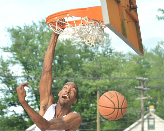 WARREN DILLAWAY / Star Beacon<br /> ANTHONY HARGROVE of Ashtabula won the West Side Shootout slam dunk contest on Friday night at the West Avenue courts in Ashtabula.