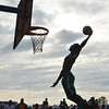 WARREN DILLAWAY / Star Beacon<br /> LAROO WELLS of Ashtabula rises above the crowd during the West Side Shootout dunk contest on Friday at the West Avenue courts in Ashtabula.
