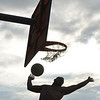 WARREN DILLAWAY / Star Beacon<br /> RAY JOURNIGAN follows through on a dunk in the West Side Shootout dunk contest on Friday at the West Avenue courts in Ashtabula.
