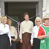 WARREN DILLAWAY / Star Beacon<br /> JANET LIPPS, assistant secretary of the Ashtabula County Antique Engine Club (with hat) prepares for a ribbon cutting ceremony on Friday at the engine club grounds in Wayne Township. (From left) Nancy Hodge, Barbara Hamilton, Marilyn Johnson, Evelyn Zaebst and Lipps participated in the cutting and rang the bell.