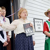 WARREN DILLAWAY / Star Beacon<br /> BARBARA HAMILTON (holding book), an author and historian, addresses a crowd during the dedication of the Wayne Township School replica on Friday at the Ashtabula County Antique Enginge Club grounds in Wayne Township. Janet Lipps (far right), assistant secretary, and Nandy Hodge (far left) and Marilyn Johnson (second from left) and Evelyn Zaebst (hidden) all participated in a ribbon cutting ceremony on Friday morning.