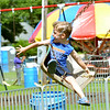 WARREN DILLAWAY / Star Beacon<br /> LOGAN GOODRICK, 4, of Painesville, enjoys an amusement ride at Lakeview Park during the Conneaut Fourth of July Festival on Saturday afternoon.