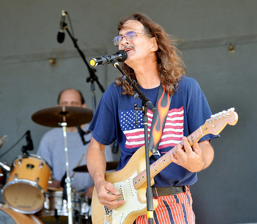 WARREN DILLAWAY / Star Beacon<br /> ED DANA of  the Larry, Darryl, Darryl and Cheryl band performs on Saturday on the main stage at Lakeview Park during the Conneaut Fourth of July Festival.