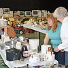 WARREN DILLAWAY / Star Beacon<br /> KATHY KAPLAN (left) and Mary Ann Steadman prepare for Our Lady of Peace Parish Rummage Sale.