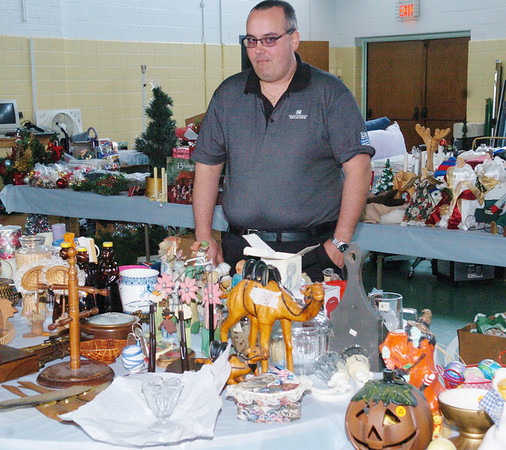 WARREN DILLAWAY / Star Beacon<br /> ROBERT DILLE checks out items for Our Lady of Peace Parish Rummage Sale.