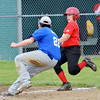 WARREN DILLAWAY / Star Beacon<br /> LOGAN SINES (left) of the Grand Valley Junior League Mustangs prepares to tag Huner Senita of Jefferson Tuesday evening at Havens Complex.