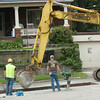 WARREN DILLAWAY / Star Beacon<br /> A STREET maintenance project kept Conneaut city workers and contractors busy along Broad Street on Friday near the 16th Street intersection.