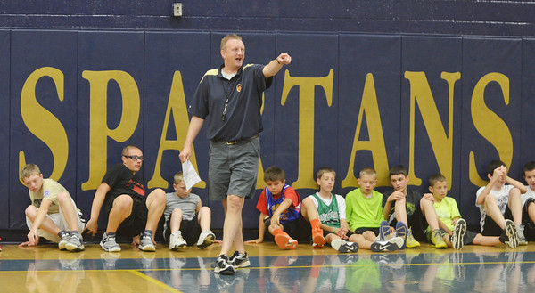 WARREN DILLAWAY / Star Beacon<br /> TIM TALLBACKA, Conneaut boys basketball coach, instructs campers during the Conneaut Bench Club Youth Skills Camp Thursday afternoon at Conneaut High School.