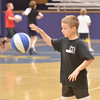 WARREN DILLAWAY / Star Beacon<br /> JAMES ROUX JR., who will be a fourth grader at Gateway Elementary, works on his ball handling after receiving a basketball following the Conneaut Bench Club Youth Skills Camp Thursday morning at Conneaut High School.