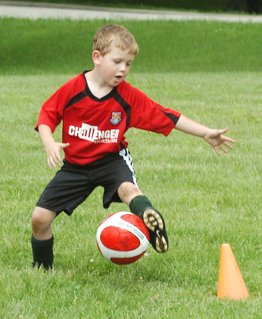 WARREN DILLAWAY / Star Beacon<br /> ERIC CAMPBELL, 6, of Conneaut, tries to save the ball during a soccer game on Friday during a Challenger Soccer Camp at Conneaut Township Park.