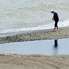 WARREN DILLAWAY / Star Beacon<br /> A WOMAN walking the beach at Conneaut Township Park is reflected in the water.