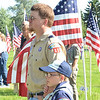 WARREN DILLAWAY / Star Beacon<br /> DYLAN FRENCH, 9, of Kingsville Township and Cub Scout Pack 11, watches a Flag Day Ceremony with his father Jeremy at Greenlawn Memory Gardens on Friday evening.
