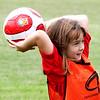 WARREN DILLAWAY / Star Beacon<br /> KIRA MUCCI, 8, of Conneaut, prepares to inbound the ball during a soccer camp at Conneaut Township Park.
