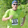 WARREN DILLAWAY / Star Beacon<br /> TOM WEST finishes the Greenway Five Mile on Saturday in Austinburg Township.