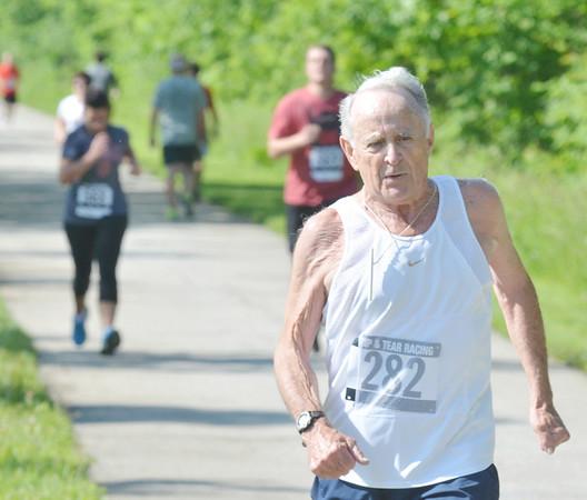 WARREN DILLAWAY / Star Beacon<br /> DON GILL of Ashtabula finishes the Greenway Five Mile on Saturday in Austinburg Township.